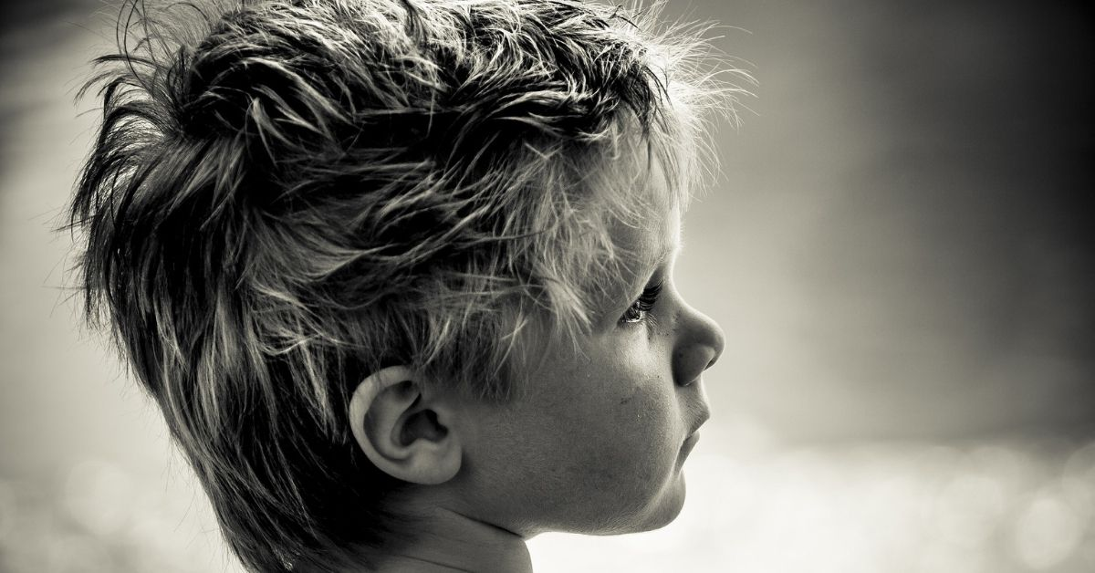 Cute little boy with tousled blonde hair