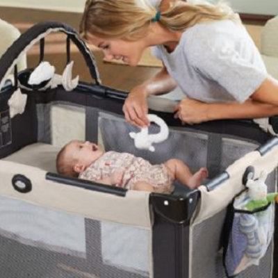 Mother playing with her baby in a Graco on the Go