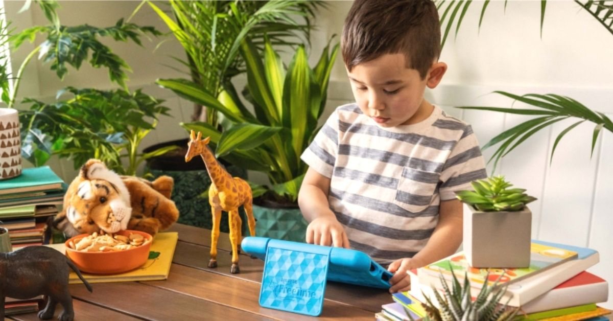 Little Boy Enjoying Playing Educational Games on Fire 7 Tablet