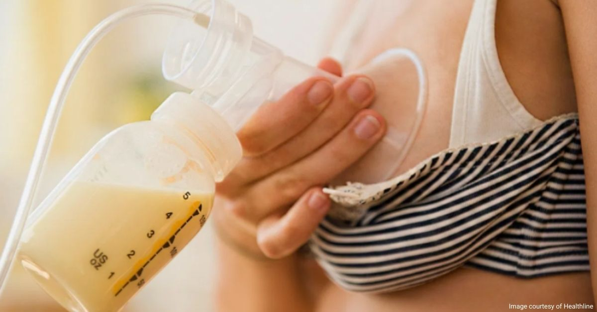 Mother using a breast pump