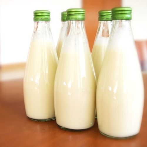 Glass bottles filled with organic milk