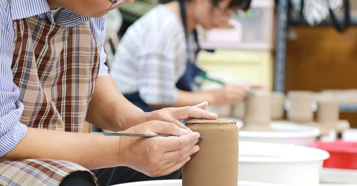 Students taking a pottery class