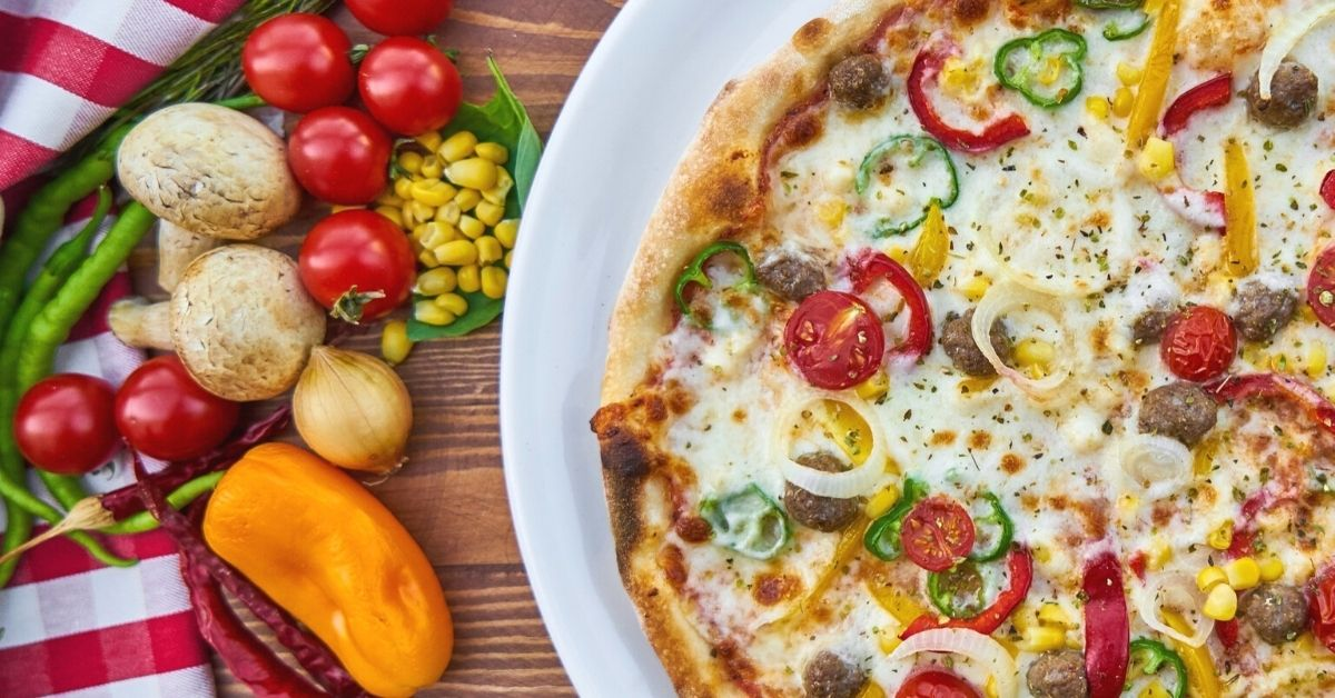 A plate of healthy vegetable pizza