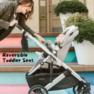 Mother with her happy baby in an UPPAbaby Cruz V2 Stroller