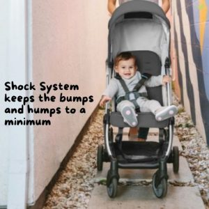 Toddler comfortably riding an UPPAbaby MINU shock-absorbent stroller