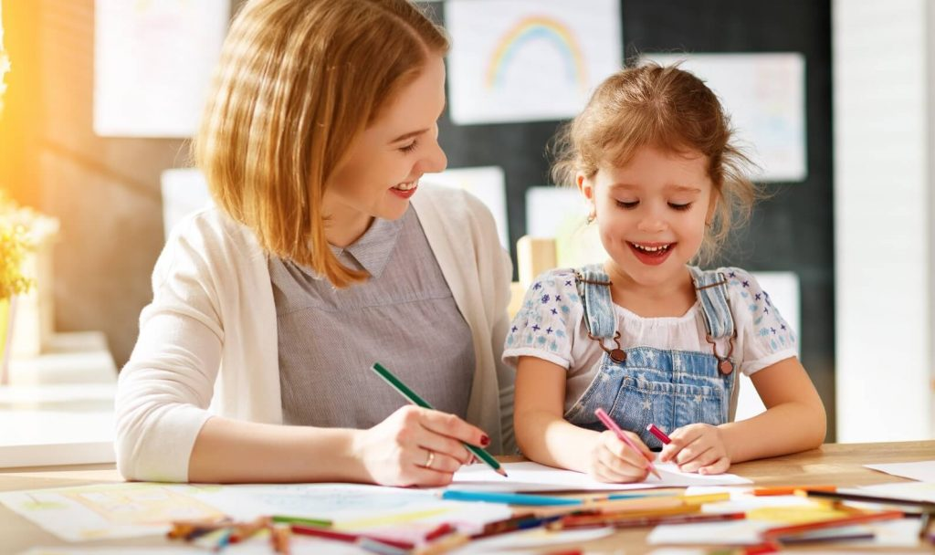 mother and daughter are bonding by doing art