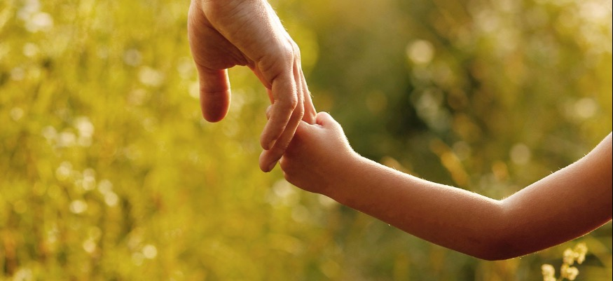 Dad holding his daughters hand